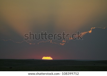 Sunset and God-rays on South Dakota - stock photo