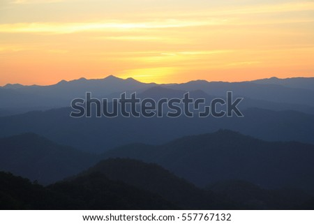 sunset and layer of mountain