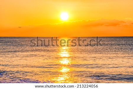 Sunset and ocean - stock photo