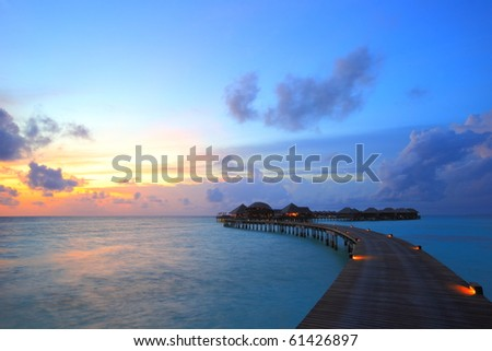 sunset and overwater villas - stock photo