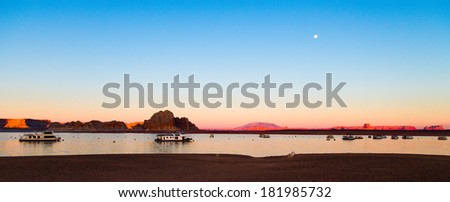 sunset and red sandstone cliffs on the shores of Lake Powell. Arizona, United States - stock photo