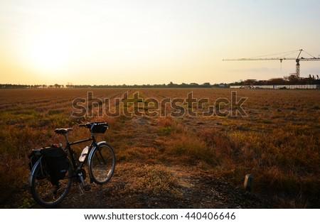 sunset and sunrise, bike for health - stock photo