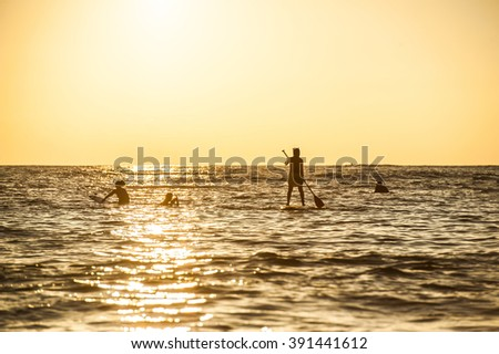 Sunset and surfer silhouette