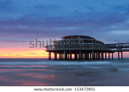 Sunset and the pier of Scheveningen. The Netherlands - stock photo