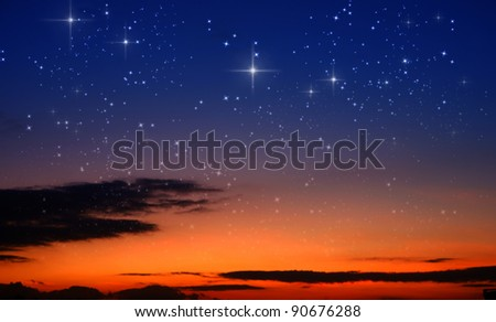 sunset and the stars - stock photo