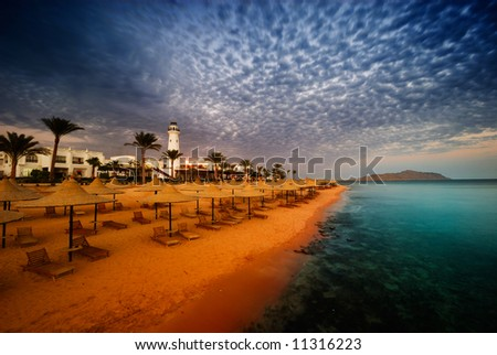 sunset and turquoise ocean in sharm el sheikh, egypt - stock photo