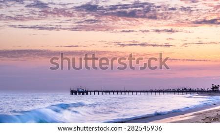 Sunset and waves at Balboa Pier, Newport Beach, California - stock photo