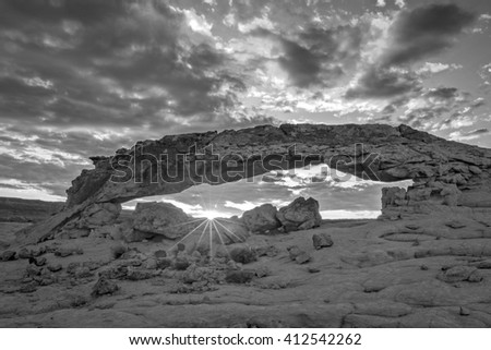 Sunset arch in black and white, Utah, USA. - stock photo