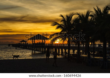 sunset at a tropical beach - stock photo