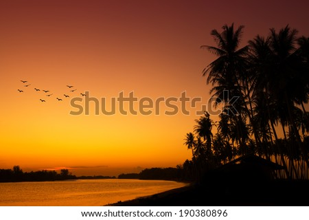 Sunset at a tropical beach in Asia - stock photo