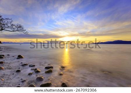 Sunset at Acadia Beach near University of British Columbia, Canada - stock photo