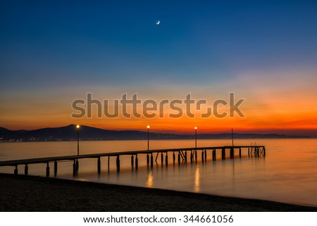 Sunset at beach with new moon