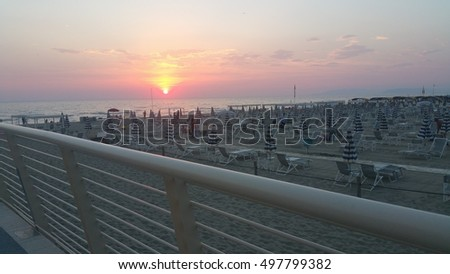 sunset at camaiore lido from bridge
