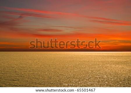 Sunset at coast of the sea - stock photo