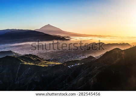 Sunset at evening in mountains and blue sky with fog and Teide volcano on background in Tenerife Canary island, Spain at spring or summer