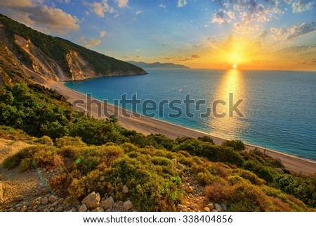 Sunset at famous Myrtos beach - Kefalonia - Greece - stock photo