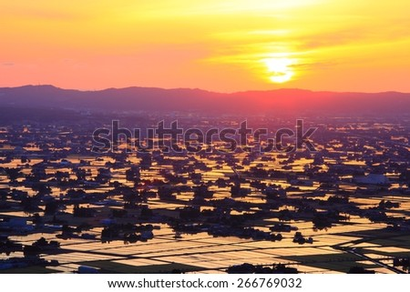 Sunset at flooded rice field, Sankyoson, Toyama, Japan  - stock photo