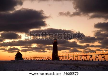 Sunset at Grand Haven Lighthouse, Michigan, USA - stock photo