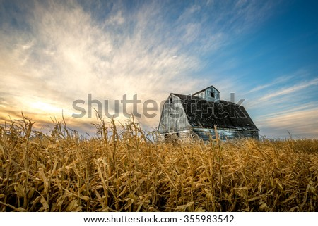 Sunset at harvest time with an abandoned corn crib - stock photo