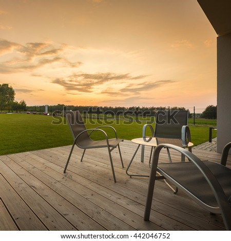 Sunset At Home Patio With Simple Furniture Set