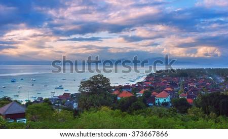 Sunset at island Lombongan near Bali - stock photo