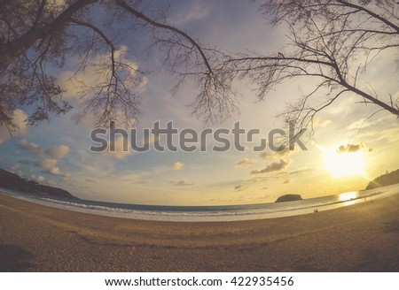 Sunset at kata beach phuket thailand. - stock photo