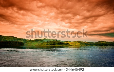 Sunset at Lake Bunyonyi in Uganda, Africa, at the borders of Uganda, Congo and Rwanda, not far from the Bwindi National Park, home of the last mountain gorillas - stock photo