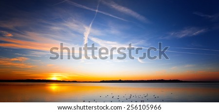 sunset at lake chiemsee  - stock photo
