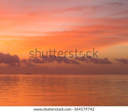 sunset at Maldivian beach - stock photo