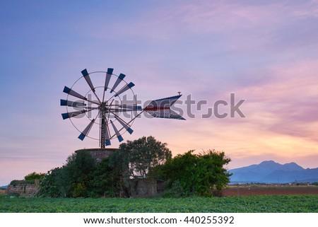 sunset at Mallorca, Typical & historical windmill - Mallorca (Spain)                  - stock photo