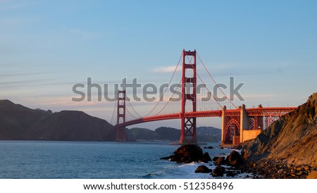 Sunset at Marshall's Beach with the famous Golden Gate Art Deco Suspension Bridge , San Francisco, California USA