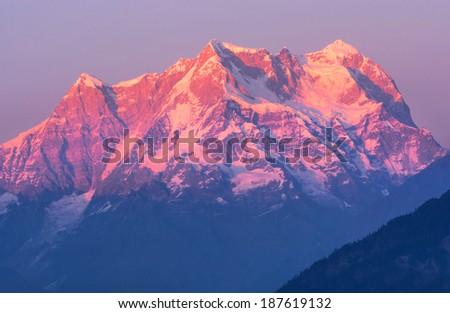 "sunset at mountain ""Chaukhambha"" in Indian Himalaya - stock photo"
