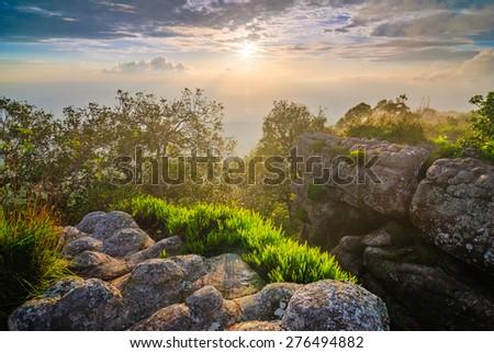 Sunset at mountain peak, Phu Hin Rong Kla National Park, north of  Thailand - stock photo