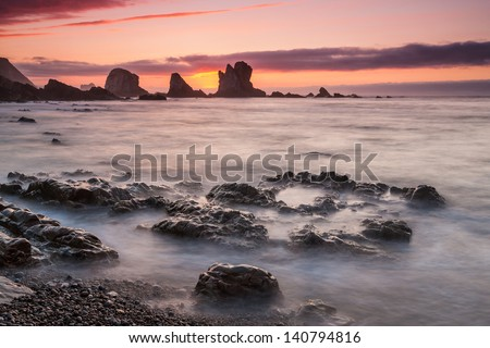 Sunset at Playa del Silencio, Asturias, Spain - stock photo