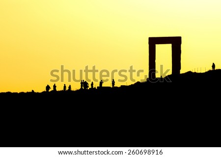 Sunset at Portara, ancient unfinished temple of Apollo on greek island of Naxos, Cyclades - stock photo