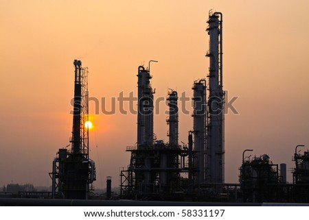 Sunset at refinery - stock photo