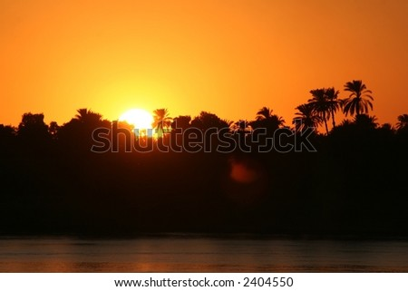 sunset at river nile - stock photo