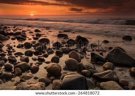 Sunset at Slowinski National Park in Poland. Baltic sea coastline - stock photo