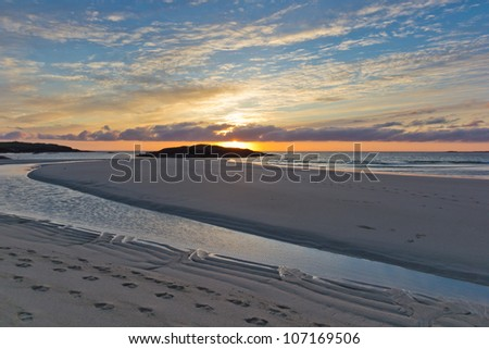 Sunset at Tangasdale  - Outer Hebrides The beach here is considered to be one of the best in the Hebrides. Each July Tangasdale hosts  the Barra Fest traditional music festival. - stock photo