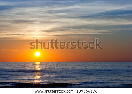 Sunset at the Baltic sea in a summer time - stock photo