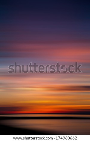 Sunset at the beach. Blurred panning motion. Abstract  - stock photo
