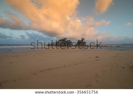 sunset at the beach  with beautiful cloud formation and colour.