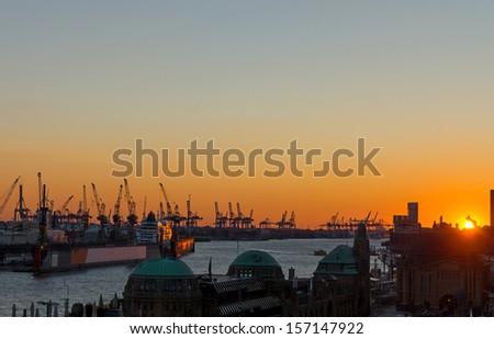 Sunset at the Hamburg harbor - stock photo