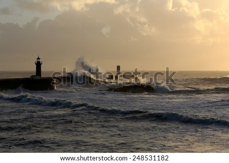 Sunset at the harbor of the river Douro mouth, Porto, Portugal - stock photo