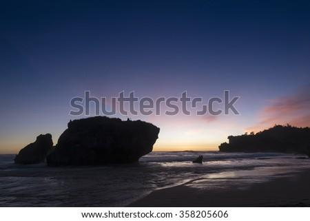 Sunset at the Kukup beach near Jogjakarta, Java,  Indonesia - stock photo