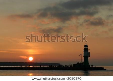 sunset at the mole - stock photo