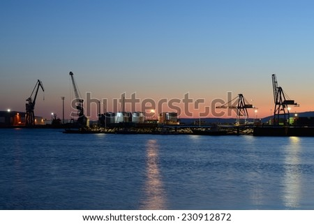 Sunset at the port - stock photo