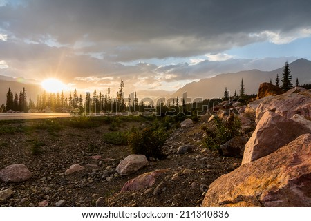 Sunset at the Rocky Mountains Road to jasper in canada - stock photo