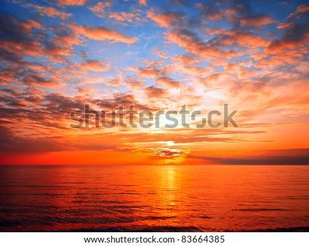 sunset at the sea - stock photo