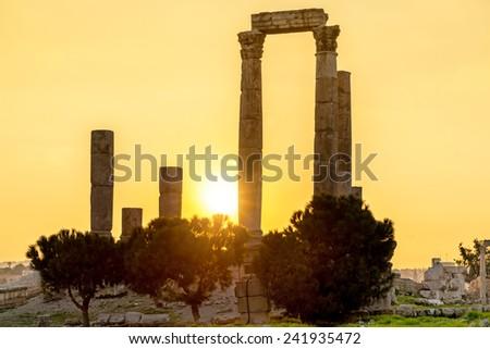 Sunset at the Temple of Hercules in Amman Citadel, Jordan. Amman Citadel is known in Arabic as Jabal al-Qal'a.  - stock photo
